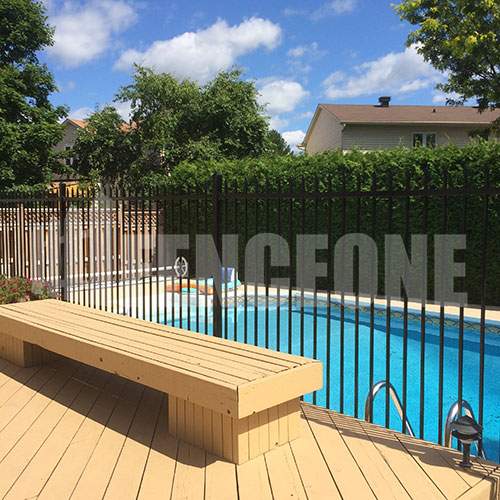 black iron fence surrounding pool